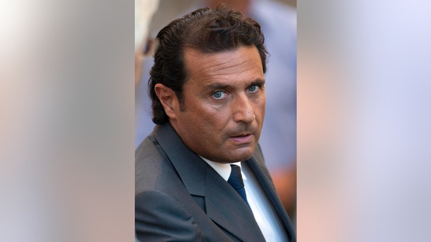 """FILE - In this Monday, Sept. 23, 2013 file photo, Captain Francesco Schettino leaves the court room of the converted Teatro Moderno theater at the end of a hearing of his trial, in Grosseto, Italy. A prosecutor in the trial for the shipwreck of the Costa Concordia contends that 32 people died not because the luxury cruise liner crashed into a reef, but due to """"chaos, delays, errors"""" under the captain's watch. Prosecutor Alessandro Leopizzi was making final arguments Friday in the trial in Grosseto, Tuscany, of Francesco Schettino, who captained the Italian liner which capsized near tiny Giglio island in 2012. (AP Photo/Andrew Medichini, File)"""
