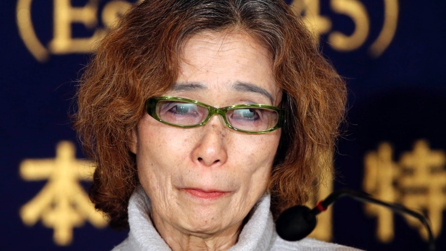 Jan. 23, 2015: Junko Ishido, mother of Japanese journalist Keni Goto taken hostage by Islamic State, speaks during a press conference in Tokyo.