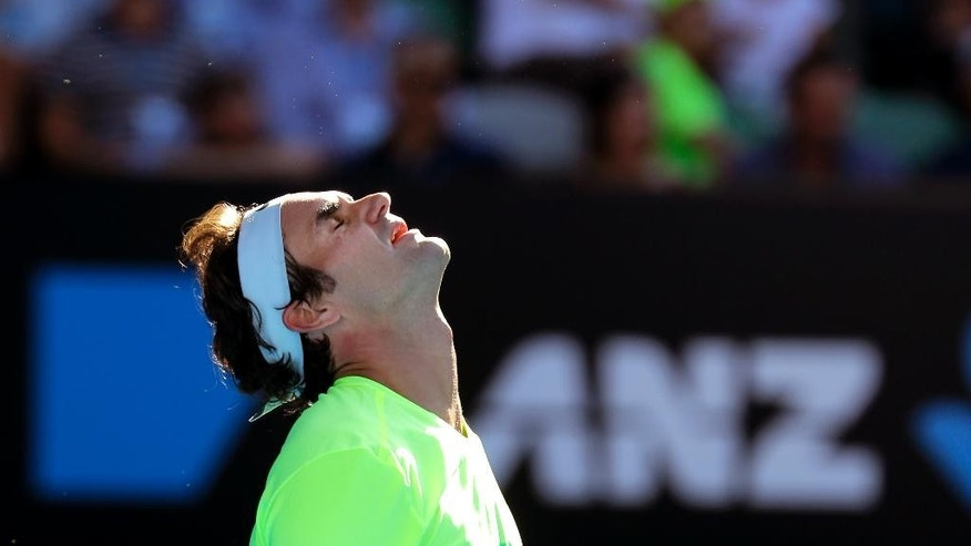 Roger Federer of Switzerland reacts as he plays Andreas Seppi of Italy during their third round match at the Australian Open tennis championship in Melbourne, Australia, Friday, Jan. 23, 2015. (AP Photo/Bernat Armangue)