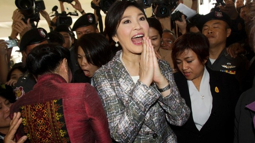 Jan. 22, 2015: Thailand's former Prime Minister Yingluck Shinawatra, center, leaves parliament in Bangkok. (AP Photo/Sakchai Lalit)