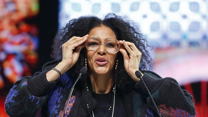 American humorist, writer and UNICEF Goodwill Ambassador Sarah Jones performs during a panel at the World Economic Forum in Davos, Switzerland, Saturday, Jan. 24, 2015. (AP Photo/Michel Euler)