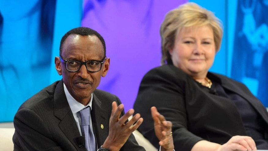 President of Rwanda Paul Kagame, left, and Prime Minister of Norway Erna Solberg, right, attend a panel session on the last day of the 45th annual meeting of the World Economic Forum, WEF, in Davos, Switzerland, Saturday, Jan. 24, 2015. (AP Photo/Keystone, Laurent Gillieron)