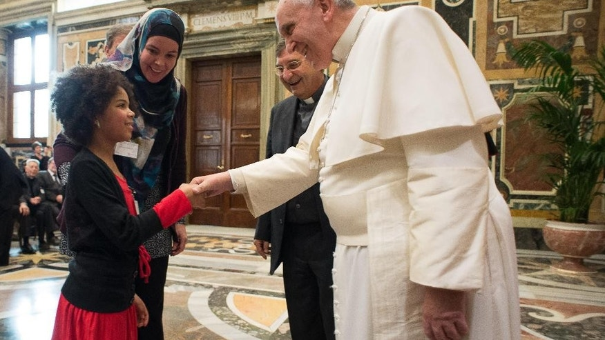 "Pope Francis meets members of the Pontifical Institute of Arab and Islamist Studies, at the Vatican Saturday, Jan. 24, 2015. Pope Francis says the most effective ""antidote"" to violence among Christians and Muslims is learning about each side's differences and then accepting them. Francis also told participants Saturday of a meeting promoted by the Pontifical Institute of Arab and Islamist Studies that only by carefully listening to each other can interreligious dialogue make progress. (AP Photo/L'Osservatore Romano, Pool)"