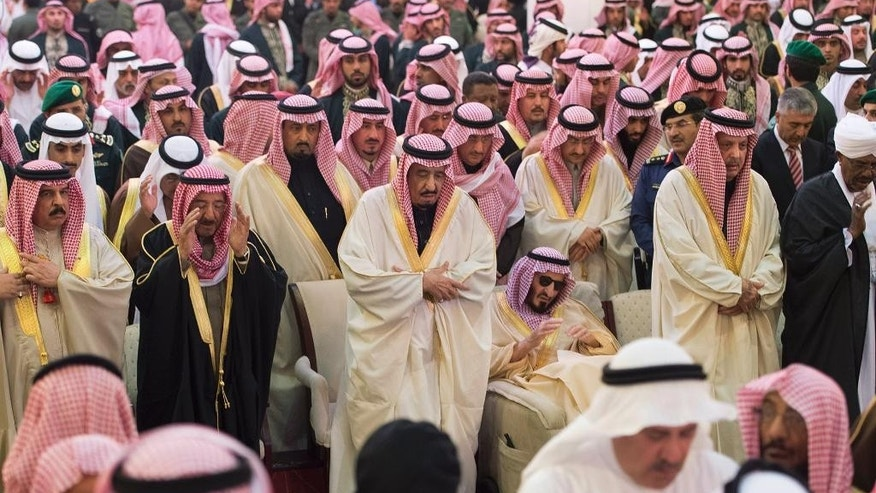 In this photo provided by the Saudi Press Agency, Saudi Arabia's newly enthroned King Salman, center, relatives of late King Abdullah, who died early Friday, and other mourners during his funeral at the Imam Turki bin Abdullah mosque in Riyadh, Saudi Arabia, Friday, Jan. 23, 2015. Saudi state TV reported early Friday that King Abdullah died at the age of 90. (AP Photo/SPA)