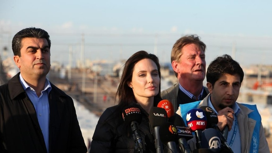 Special Envoy of the United Nations High Commissioner for Refugees (UNHCR), Angelina Jolie delivers a speech during a press conference in Khanke camp in Dahuk, north of the Kurdistan region, 260 miles (430 kilometers) northwest of Baghdad, Iraq, Sunday, Jan. 25, 2015. Actress and United Nations envoy Angelina Jolie called on the international community to do more for people in Iraq and Syria, during a visit to a refugee camp in northern Iraq on Sunday. (AP Photo/Seivan M. Selim)