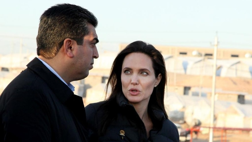 Special Envoy of the United Nations High Commissioner for Refugees (UNHCR), Angelina Jolie speaks with Dohuk governor, Farhad Atrushi, during a press conference in Khanke camp in Dahuk, north of the Kurdistan region, 260 miles (430 kilometers) northwest of Baghdad, Iraq, Sunday, Jan. 25, 2015. Actress and United Nations envoy Angelina Jolie called on the international community to do more for people in Iraq and Syria, during a visit to a refugee camp in northern Iraq on Sunday. (AP Photo/Seivan M. Selim)