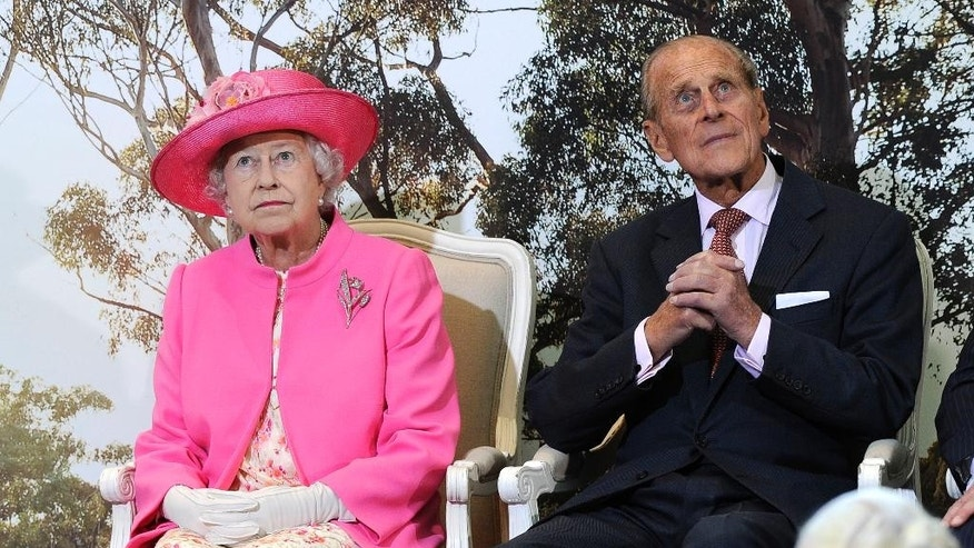FILE - In this Oct. 26, 2011 file photo, Britain's Queen Elizabeth II, left, and her husband Prince Philip attend the opening of the new Royal Children's Hospital in Melbourne, Australia. Australia's prime minister on Monday, Jan. 26, 2015 dismissed criticism of his decision to the Duke of Edinburgh an Australian knight, saying Philip has a long history of service Down Under. Prime Minister Tony Abbott's announcement that the duke would be awarded Australia's highest honor came on Australia's national holiday, prompting some to question the wisdom of knighting a British royal on a day meant to commemorate Australians. (AP Photo/Andrew Brownbill, File)
