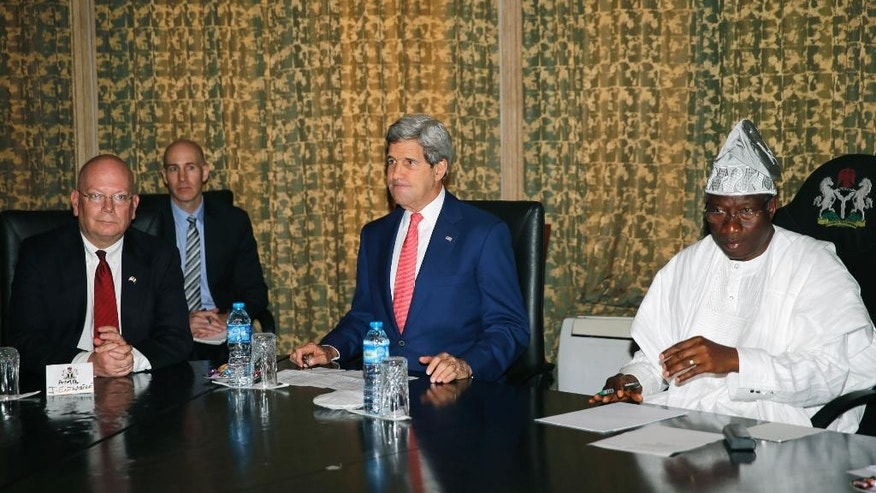 U.S. Ambassador to Nigeria James Entwistle, left, US Secretary of State John Kerry, centre,  sit beside Nigeria's President Goodluck Jonathan, at the State House, in Lagos, Nigeria, Sunday,  Jan. 25, 2015. U.S. Secretary of State John Kerry's plan to stop in Nigeria for meetings with the two leading candidates in the upcoming presidential election signals deep U.S. concerns about pos telection violence in a country already devastated by an al-Qaida-linked insurgency. (AP Photo/Akintunde Akinleye, Pool)