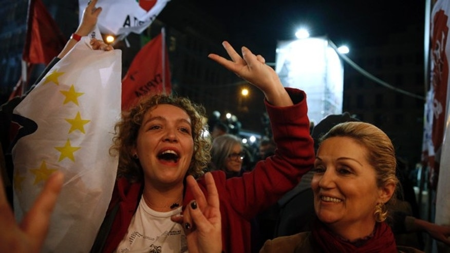 Jan. 25, 2015: Supporters of left-wing Syriza party react after exit poll results in Athens.