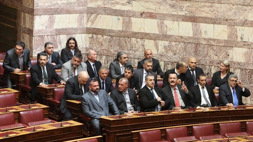"This photo taken on Thursday, May 17, 2012 shows members of parliament from the extreme right-wing Golden Dawn party, as they are seated before a swearing in ceremony at the Greek parliament in Athens. The specter of Neo-Nazism is no longer haunting Greece. It looks like it is here to stay. Even with its leader and most of its lawmakers behind bars, facing charges of participating in a ""criminal organization"" accused of murders, brutal attacks on migrants and others, extortion and arson, the extreme-right, anti-immigrant party with Nazi roots, appears to be headed for third place in national election on Sunday, Jan 25, 2015. (AP Photo/Thanassis Stavrakis, File)"