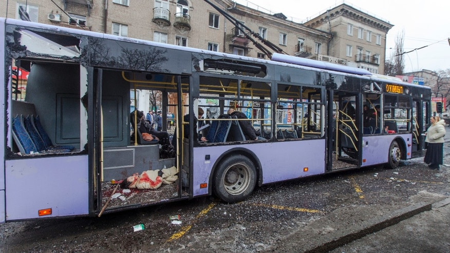 Jan. 22, 2015: Passengers killed when a trolley bus was damaged by a mortar shell are seen inside a bus in Donetsk, eastern Ukraine.