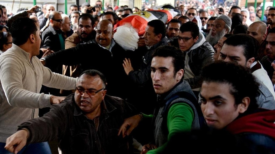 Egyptians carry the coffin of Shaimaa el-Sabagh, a 32-year-old mother of one from the Mediterranean port city of Alexandria, who was shot Saturday in downtown Cairo while taking part in a gathering commemorating the nearly 900 protesters killed in the revolution, during her funeral procession in Alexandria, Egypt, Sunday, Jan. 25, 2015. Protests and stepped-up security came as activists mourned the death el-Sabagh. Activists blame police for her death. The government says it is investigating. (AP Photo/Heba Khamis)