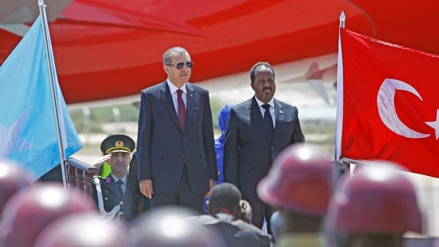 Turkey's President Recep Tayyip Erdogan, left, and Somalia President Hassan Sheikh Mohamud attend a ceremony in the capital Mogadishu, Sunday Jan. 25, 2015. Under tight security Turkish President, Recep Tayyip Erdogan, launched development projects sponsored by his government including an airport terminal in the Somali capital, Mogadishu. (AP Photo/Farah Abdi Warsameh)