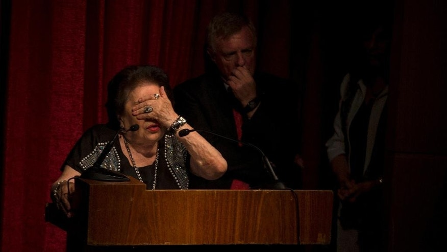 Holocaust survivor Rotsztejn Eugenia Unger takes part in a Holocaust Memorial Day ceremony in Buenos Aires, Argentina, Tuesday, Jan. 27, 2015, at the Jewish community center that was bombed in 1994. The Jewish community is boycotting the Argentine government's official ceremony in protest over the mysterious death of prosecutor Alberto Nisman, who was found dead hours before he was set to elaborate on damaging allegations that President Cristina Fernandez shielded Iranian officials wanted in the terrorist bombing of the Jewish center, that killed 85 people and injured more than 200. (AP Photo/Ivan Fernandez)