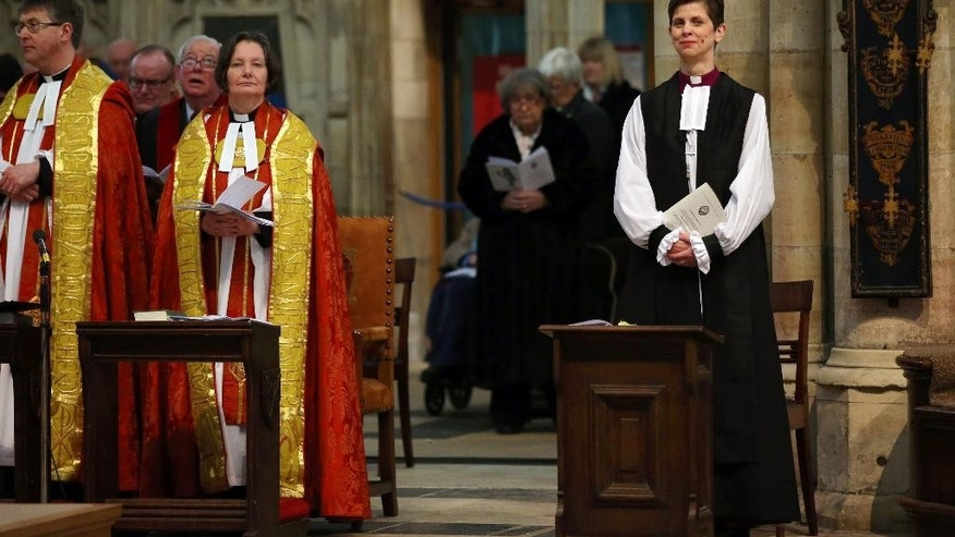 Jan. 26, 2015 - The Rev. Libby Lane, right, during her consecration as the 8th Bishop of Stockport, at York Minster, England. Male domination in the leadership of the Church of England has ended, as the 500-year-old institution consecrated its first female bishop.