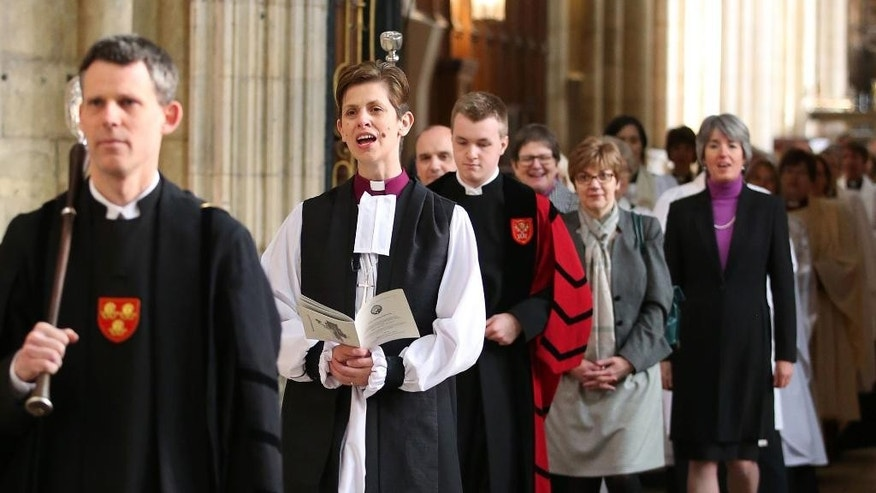 The Rev. Libby Lane, second left, arrives at York Minster, England, where she will be consecrated as the eighth Bishop of Stockport, Monday Jan. 26, 2015. Male domination in the leadership of the Church of England is coming to an end, as the 500-year-old institution consecrates its first female bishop. (AP Photo/PA, Lynne Cameron) UNITED KINGDOM OUT  NO SALES  NO ARCHIVE