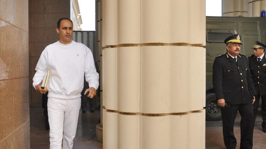 FILE - In this Tuesday, Jan. 17, 2012 file photo, Gamal Mubarak, son of former Egyptian president Hosni Mubarak, left, arrives at a court house in Cairo, Egypt. Egyptian security officials say two sons of ousted President Hosni Mubarak have been released from prison, nearly four years after they were first arrested along with their father. (AP Photo/Mohammed al-Law, File)