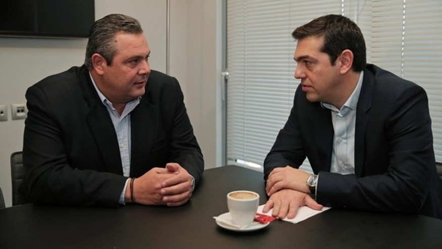 Jan. 26, 2015- Alexis Tsipras, right, leader of Greece's left-wing main opposition Syriza party, and Panos Kammenos, chairman of the right-wing Independent Greeks party, talk during their meeting in Athens.