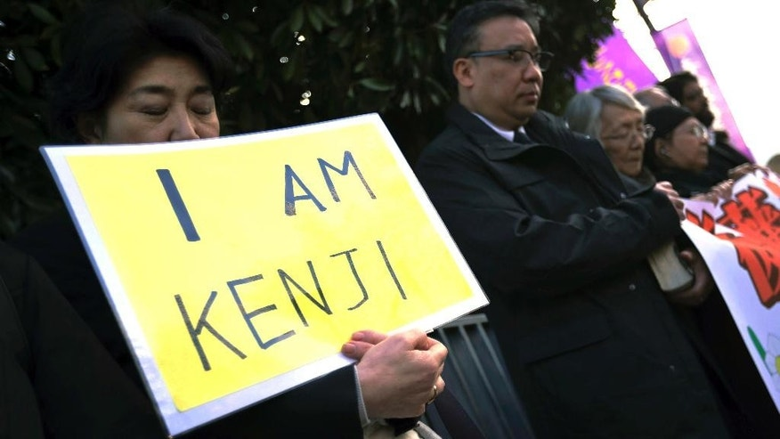 "Protesters chant ""Free Goto"" during a demonstration in front of the Prime Minister's Official residence in Tokyo, Tuesday, Jan. 27, 2015. The plight of freelance journalist Kenji Goto, taken captive by Islamic State group militants, has gripped Japan, and the people's hopes for his safety are now on Facebook with a simple, unifying plea: ""I am Kenji."" As of Tuesday, the ""I am Kenji"" Facebook page had more than 25,000 ""likes"" and is continuing to grow. (AP Photo/Eugene Hoshiko)"
