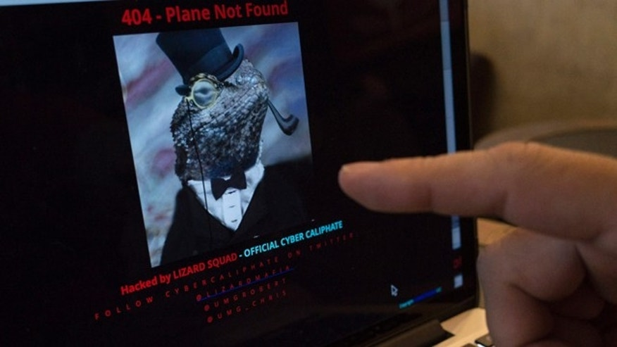 Jan. 26, 2015: A man points at the computer screen showing Malaysia Airlines' hacked website at a cafe in Petaling Jaya outside Kuala Lumpur, Malaysia. The airline's site was changed on Monday, at first with a message saying '404 - Plane Not Found' and that it was 'Hacked by Cyber Caliphate.' The browser tab for the website said 'ISIS will prevail.' (AP Photo/Joshua Paul)