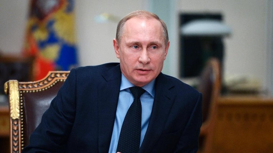 Russian President Vladimir Putin speaks during a cabinet meeting at the Novo-Ogaryovo residence outside Moscow, Russia, Monday, Jan. 26, 2015. The meeting focused on the government's anti-crisis plan. (AP Photo/RIA-Novosti, Alexei Nikolsky, Presidential Press Service)