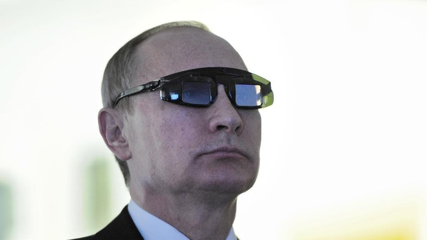 "Russian President Vladimir Putin wears special glasses as he visits a recearch facility in ""Gorny"" University in St. Petersburg on Monday, Jan. 26, 2015. In televised comments after a meeting with students in St. Petersburg, President Vladimir Putin said that Ukraine's army was at fault for the increase in violence  and accused it of using civilians as ""cannon fodder"" in the conflict. ""(Ukraine's army) is not even an army, it's a foreign legion, in this case a foreign NATO legion,"" Putin said. ""They have totally different goals, connected to the geopolitical containment of Russia, which absolutely do not coincide with the national interests of the Ukrainian people.""  (AP Photo/RIA Novosti Kremlin, Mikhail Klimentyev, Presidential Press Service)"