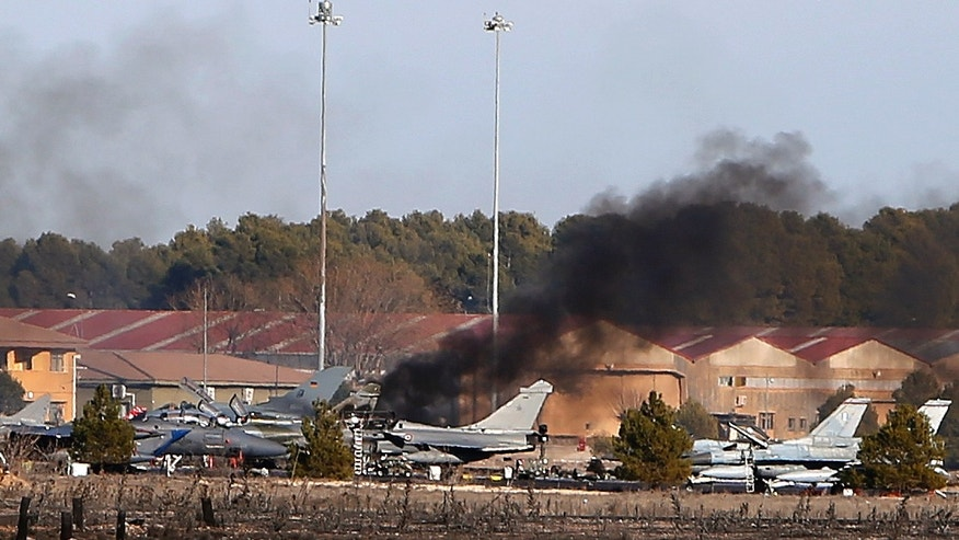 Jan. 26, 2015 - Smoke rises from a military base after a plane crash in Albacete, Spain. A Greek F-16 fighter jet crashed into other planes on the ground during NATO training in southeastern Spain Monday, killing at least 10 people, Spain's Defense Ministry said. Another 13 people were injured in the incident at the Los Llanos base.
