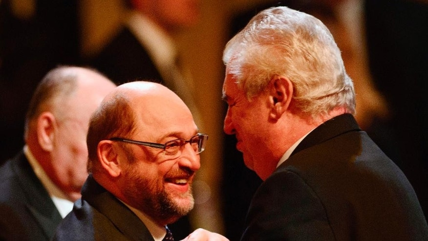 Czech President Milos Zeman, right, shakes hands with President of the European Parliament Martin Schulz, at a reception held on the occasion of a conference on the Holocaust in Prague, Czech Republic, on Monday, Jan. 26, 2015. (AP Photo/CTK, Michal Kamaryt) SLOVAKIA OUT