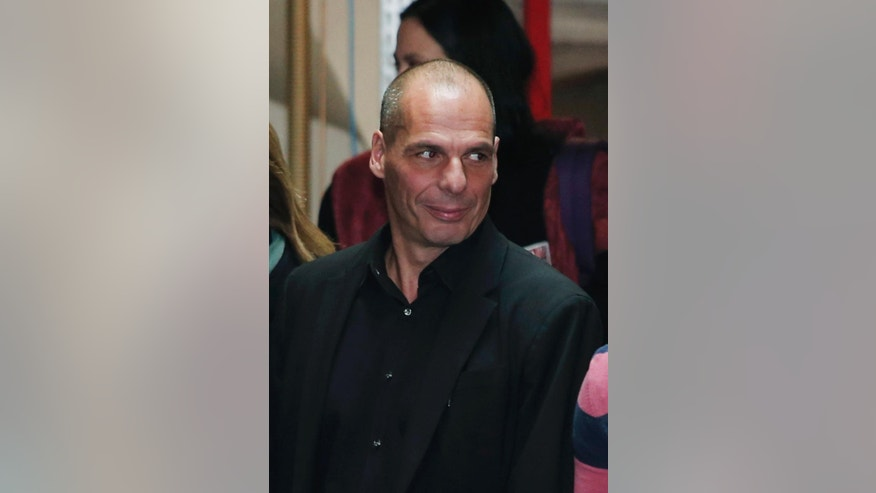 This photo taken on Sunday, Jan. 25, 2015 shows Yanis Varoufakis as he exits Syriza left-wing party headquarters in Athens. Economist and outspoken bailout critic Yanis Varoufakis, 53, has confirmed on Tuesday, Jan. 27, 2015 in a blog post that he will be sworn in as Finance Minister under the country's new left wing government. (AP Photo/Lefteris Pitarakis)