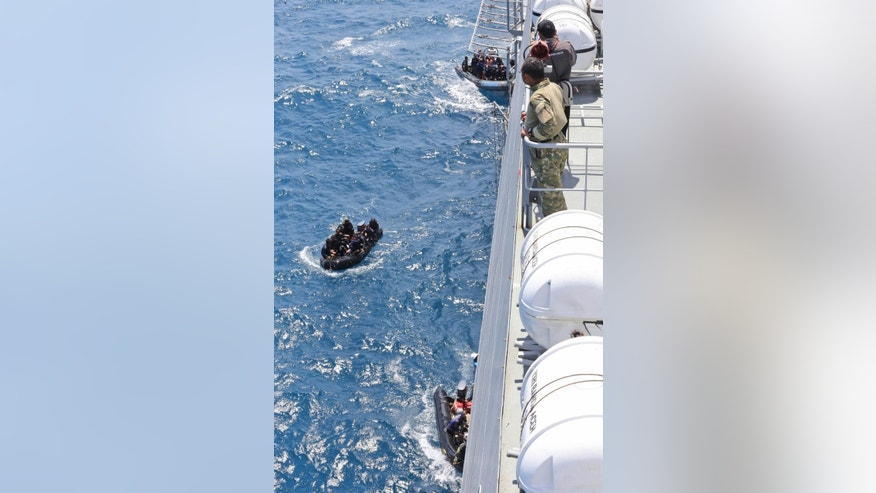 Rubber boats carrying divers approach Indonesian Navy ship KRI Banda Aceh during a recovery operation for the victims and the fuselage of AirAsia Flight 8501 on the Java Sea, Indonesia Tuesday, Jan. 27, 2015. Indonesia's military has halted its recovery efforts for the crashed AirAsia plane, including attempts to locate bodies and raise the fuselage from the Java Sea. (AP Photo/Natanael Pohan)