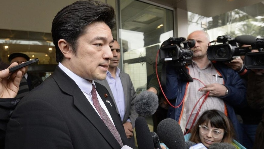 "In this Monday, Jan. 26, 2015 photo, Japan's Deputy Foreign Minister Yasuhide Nakayama, left, answers to a reporter's question in Amman, Jordan. Nakayama expressed hope that both a Japanese hostage and a Jordanian pilot held by Islamic militants will return home ""with a smile on their faces,"" as criticisms mounted Tuesday over the government's handling of the crisis. (AP Photo/Kyodo News) JAPAN OUT, MANDATORY CREDIT"