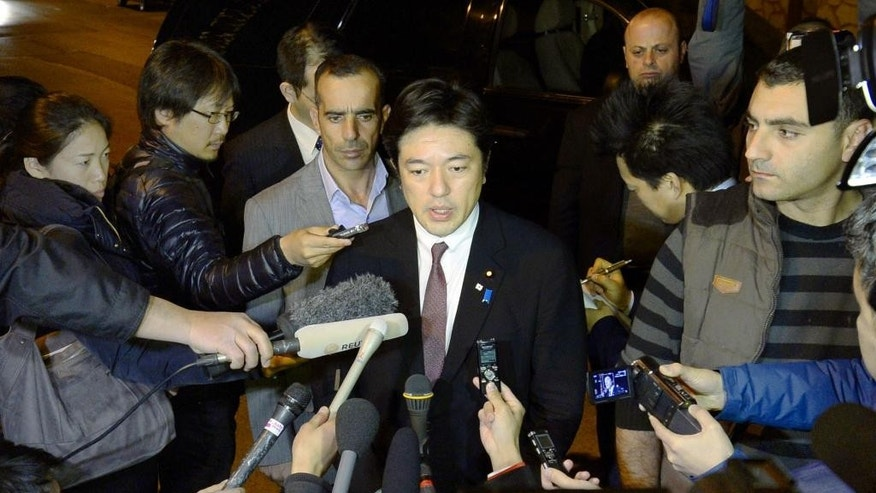 "In this late Monday, Jan. 26, 2015 photo, Japan's Deputy Foreign Minister Yasuhide Nakayama, center, answers to a reporter's question in Amman, Jordan. Nakayama expressed hope that both a Japanese hostage and a Jordanian pilot held by Islamic militants will return home ""with a smile on their faces,"" as criticisms mounted Tuesday over the government's handling of the crisis. (AP Photo/Kyodo News) JAPAN OUT, MANDATORY CREDIT"