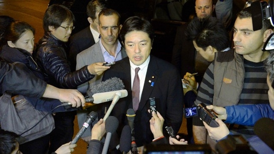 Jan. 26, 2015: Japan's Deputy Foreign Minister Yasuhide Nakayama, center, answers a reporter's question in Amman, Jordan. (AP Photo/Kyodo News)