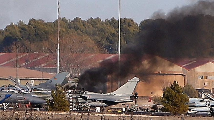 Wrecked planes are seen following a plane crash at Albacete airbase, Spain, Tuesday, Jan. 27, 2015. Spanish investigators are trying to determine the cause of Greek F-16 crash at the military base that killed 10 military personnel involved in a NATO training exercise and injured 21 when the plane crashed into at least five other parked planes after a failed takeoff. (AP Photo/Daniel Ochoa de Olza)