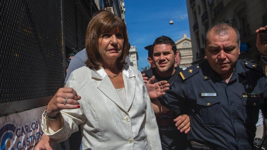 Congresswoman Patricia Bullrich enters the office of prosecutor Viviana Fein, who is investigating special prosecutor Alberto  Nisman's death, in Buenos Aires Jan. 26, 2015. The 51-year-old Nisman who accused President Cristina Fernandez of shielding Iranian suspects in the 1994 bombing of the AMIA Jewish community center that killed 85 people, was found Sunday Jan. 18, 2015, slumped in the bathroom of his apartment with a bullet wound in his head. (AP Photo/Ivan Fernandez)