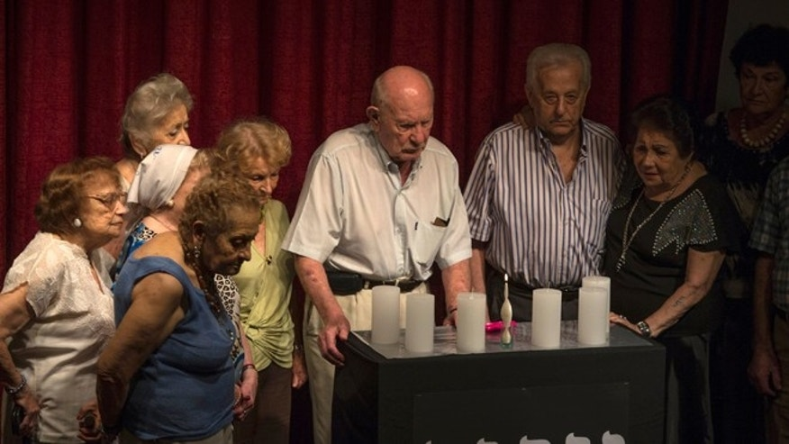 Holocaust survivors take part in a Holocaust Memorial Day ceremony in Buenos Aires, Jan. 27, 2015.