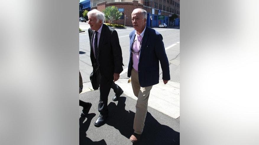 John O'Brien, right, one of the first hostages to escape a deadly siege last month, departs the New South Wales state Coroner's Court after he attended a hearing in Sydney, Thursday, Jan. 29, 2015. The coroner's inquest - a court-like proceeding convened after unusual deaths in Australia - is aimed at determining how hostages and the gunman died, and whether the tragedy could have been prevented. (AP Photo/Rick Rycroft)