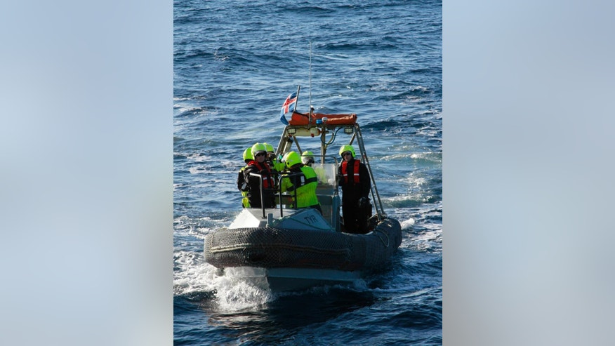 In this Jan. 14, 2015 photo, sailors from the Icelandic Coast Guard ship Tyr circle their vessel in a training exercise. The ship is part of the 19-nation Operation Triton patrolling the seas for the rising numbers of migrants, especially from Syria and Iraq, that are trying to reach Europe through its southern borders. (AP Photo/Paul Schemm)