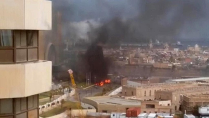 FILE - In this file image made from video posted by a Libyan blogger, the Cortinthia Hotel is seen under attack in Tripoli, Libya, Tuesday, Jan. 27, 2015. The blogger, @AliTweel, captured the moments shortly after the blast, when flames rose up from outside the hotel, appearing to be from the aftermath of the car bomb. A group affiliated with the extremist Islamic State claims a deadly and fairly complex attack on a Tripoli hotel _ indicating an expansion of the group's activities to a chaotic North African state on the cusp of Europe and suggesting a level of coordination with its core in Syria and Iraq. (AP Photo/ @AliTweel via AP video, File)