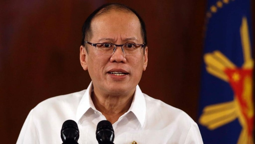 Philippine President Benigno Aquino III addresses the nation in a live broadcast Wednesday, Jan. 28, 2015 from Malacanang Palace in Manila, Philippines. Aquino warned on Wednesday that the collapse of a peace deal with the country's largest Muslim rebel group would abet terrorism and fresh violence after criticism of the accord followed the killing of 44 police commandos in what authorities said was an accidental clash with the guerrillas. (AP Photo/Bullit Marquez)