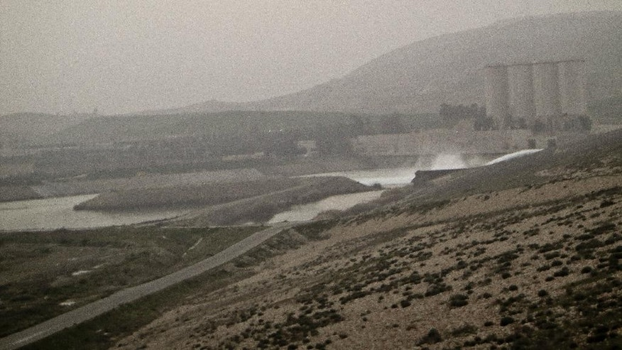 This Tuesday, Jan. 27, 2015 photo shows a general view of the Mosul Dam. The Iraqi Kurdish fighters retaking territory from Islamic State militants have found surprising ambivalence in areas they free from the jihadis' oppressive rule. Locals have swiftly shaken off the imposed Islamic lifestyle _ but as Sunnis, from the same ethnic group as the militants, many are bracing for treatment as collaborators nonetheless. An AP team traveling with the Kurds found the road to Mosul, a coveted prize in the battle for Iraq, strewn with suspicion and fear. (AP Photo/Vivian Salama)