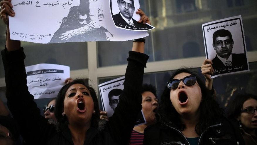 "Egyptian protesters hold posters with photos of Shaimaa el-Sabagh, an activist who was shot dead at a small peaceful protest last Saturday, and Arabic that reads, "" how many martyrs remaining for victory,"" during a women's protest in Cairo, Egypt, Thursday, Jan. 29, 2015. Dozens of women have rallied in the Egyptian capital, denouncing the killing of a female protester and blaming the police for her death during a peaceful demonstration last week. (AP Photo/Hassan Ammar)"