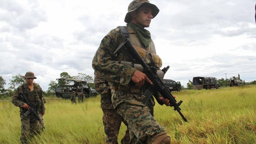 "Paraguayan army soldiers patrol the area where German citizens Robert Natto and Érika Reiser were killed by the ""Paraguayan People's Army"", (EPP) after they where kidnapped on Wednesday night at Yby Yau, in Northern Paraguay, Thursday, Jan. 29, 2015. Natto and Reiser had a cattle ranch in northern Paraguay near Paraguay's People Army operations zone. (AP Photo/Enrique Zarza)"