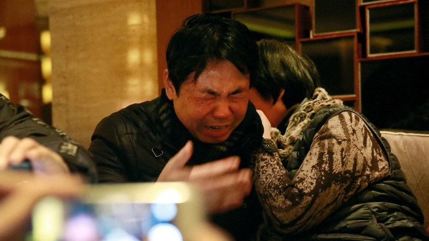 "Jiang Hui, left, and Dai Shuqin, relatives of passengers onboard the Malaysia Airlines Flight 370 that went missing on March 8, 2014, react while watching a laptop computer screen showing a pre-recorded message broadcast on Malaysian television by Malaysia's Civil Aviation Authority, in Beijing Thursday, Jan. 29, 2015. Malaysia's Civil Aviation Authority has officially declared the MH370 crash an accident, fulfilling a legal obligation that will allow efforts to proceed with compensation claims. Malaysia civil aviation chief Azharuddin Abdul Rahman said Thursday that the search for the Malaysia Airlines jet that disappeared on March 8, 2014, ""remains a proiority."" (AP Photo/Andy Wong)"
