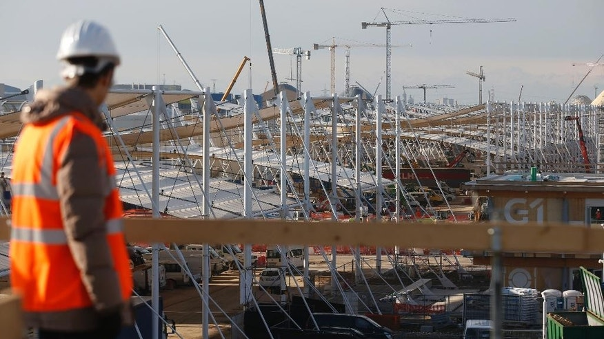In this picture taken on Jan. 26, 2015, a view from a above of the construction site of the upcoming World Exhibition Expo 2015, in Rho, in the outskirt of  Milan, Italy. With less than three months to opening day, Expo commissioner Giuseppe Sala, during a press conference in Milan Thursday, Jan. 29, 2015, gave an overall positive balance, noting that 8 million tickets had been sold, nearly one-third of the 24 million projected, and nearly 80 percent of the construction is finished. (AP Photo/Luca Bruno)