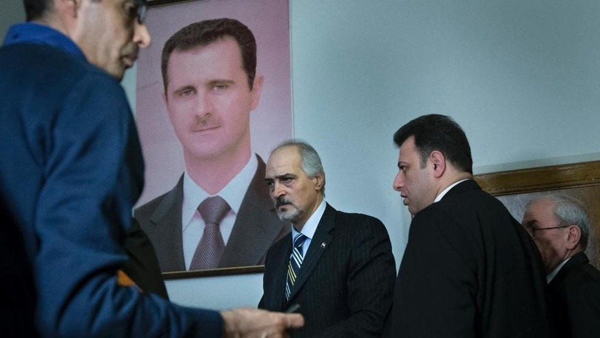 Jan. 29, 2015: Bashar Jaafari, center, who represented the Syrian government in Moscow consultations between Syrian government and opposition representatives, leaves a news conference in Moscow, Russia with a portrait of Syria's President Bashar Assad is in the background. (AP)