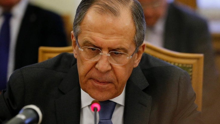 Russian Foreign Minister Sergey Lavrov speaks to participants of consultations between representatives of the Syrian government and the Syrian opposition in Moscow, Russia, Wednesday, Jan. 28, 2015. Lavrov said the meeting should pave the way for further talks on conditions for a political settlement. (AP Photo/Alexander Zemlianichenko)