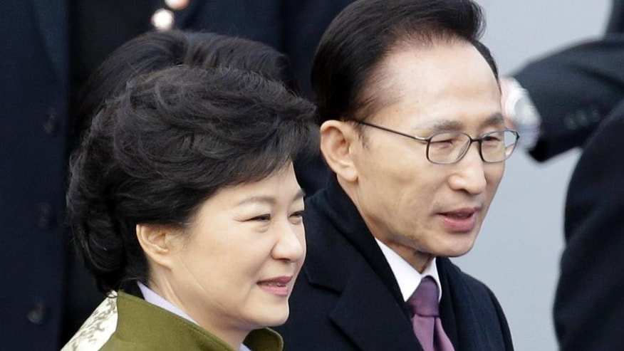 FILE - In this Feb. 25, 2013 file photo, South Korea's outgoing President Lee Myung-bak, right, walks with new President Park Geun-hye after Park's inauguration ceremony as the 18th South Korean president at the National Assembly in Seoul, South Korea. Late North Korean leader Kim Jong Il repeatedly pushed for summit talks with South Korea before his 2011 death but the plans failed because Pyongyang demanded $10 billion and large-scale shipments of food and fertilizer, Lee said in a memoir to be published next week, the first week of February, 2015. (AP Photo/Lee Jin-man, File)