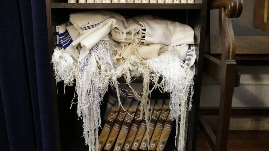 In this photo taken on Wednesday, Jan. 28, 2015, Jewish prayer shawls are stored on a shelf at the entrance of the Jewish synagogue in Lisbon. Portugal is following Spain and granting citizenship rights to the descendants of Jews it persecuted 500 years ago. (AP Photo/Francisco Seco)