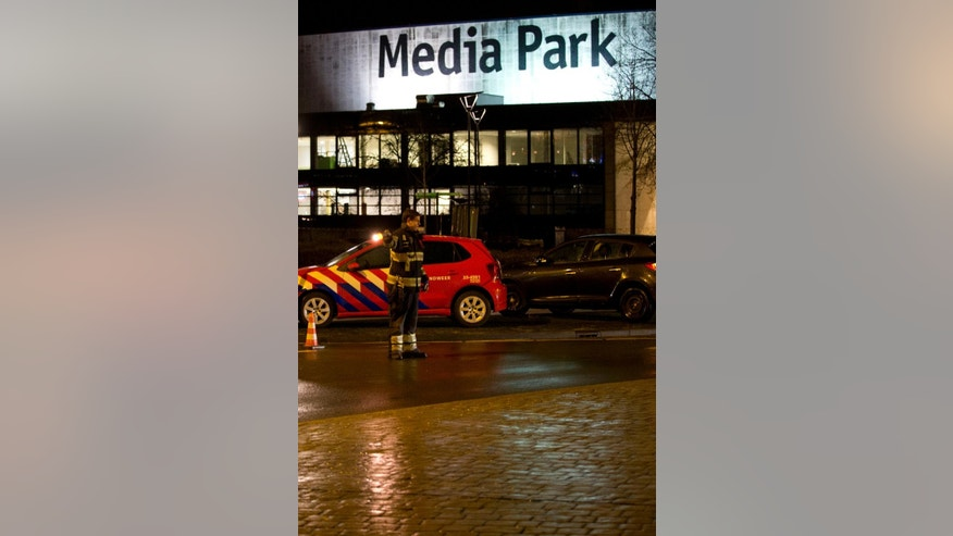 "Security forces are seen outside the Media Park in Hilversum, Netherlands, Thursday, Jan. 29, 2015. A gunman entered the headquarters of Dutch national broadcaster NOS outside Amsterdam on Thursday and demanded airtime on television, before being detained, company officials said. Jan de Jong, director of the NOS, told national radio ""Someone got into the building"" and added that the man had been taken into custody.(AP Photo/Peter Dejong)"
